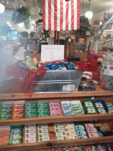 Bucket of candy at the Newtown, CT General Store. The sign says From Your Friends in KC: Justus, Evan and Harper.